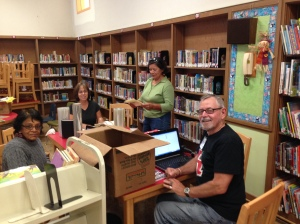 FOPSL volunteers working on Bella Vista elementary school library - Summer 2014