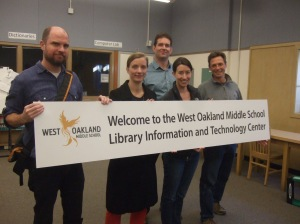Volunteers from The Focal Point design and install classy signage in the new LIT Center at West Oakland Middle School